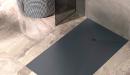 Plato de ducha de textura pizarra y color negro